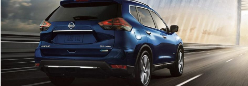 The 2018 Nissan Rogue driving down the road.
