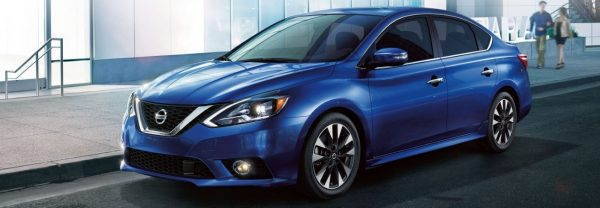 Blue 2018 Nissan Sentra parked curbside